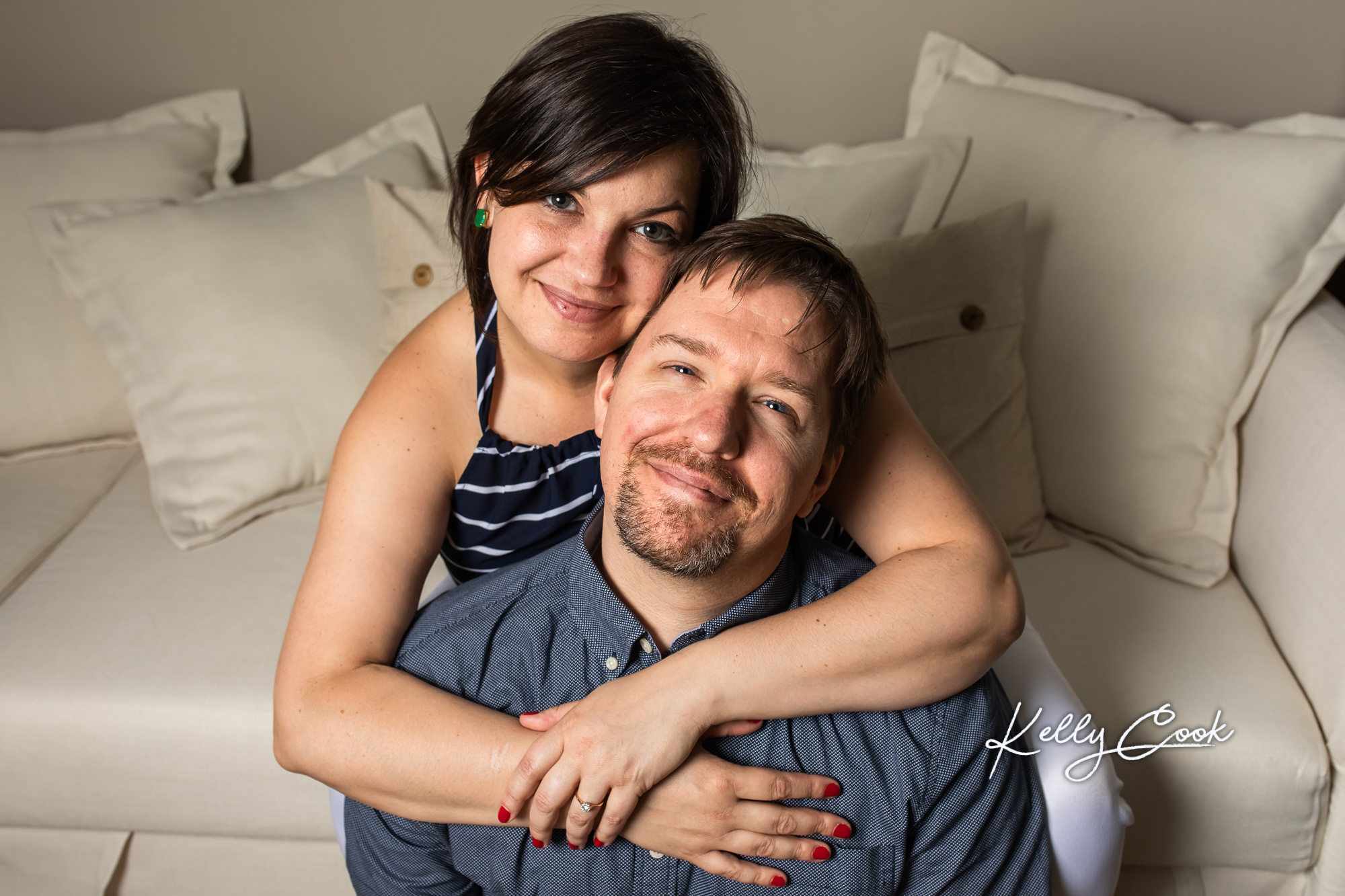 In-home lifestyle engagement photo of an engaged couple in St. Louis