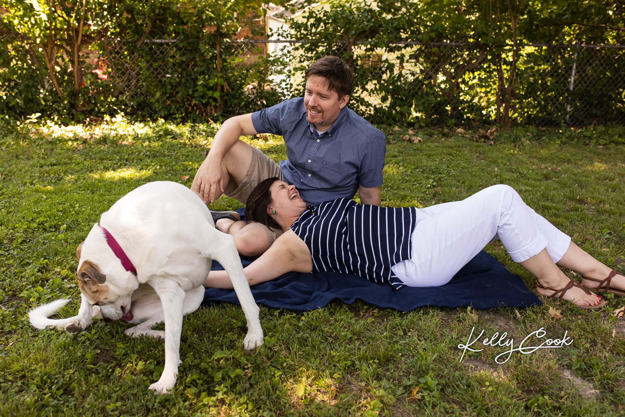 Candid lifestyle engagement photo of a couple and their dog
