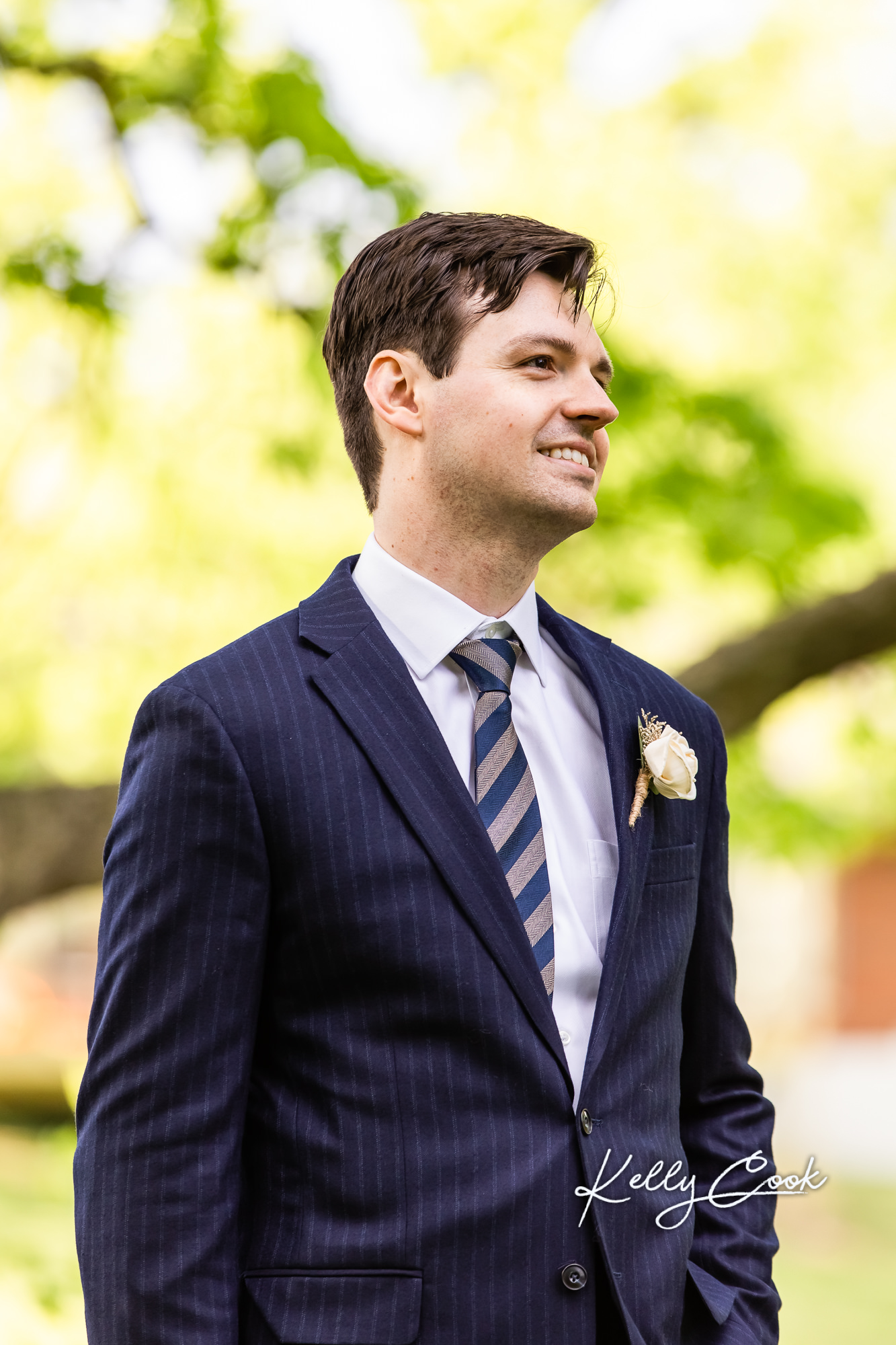 Portrait of a groom watching his bride walk down the aisle