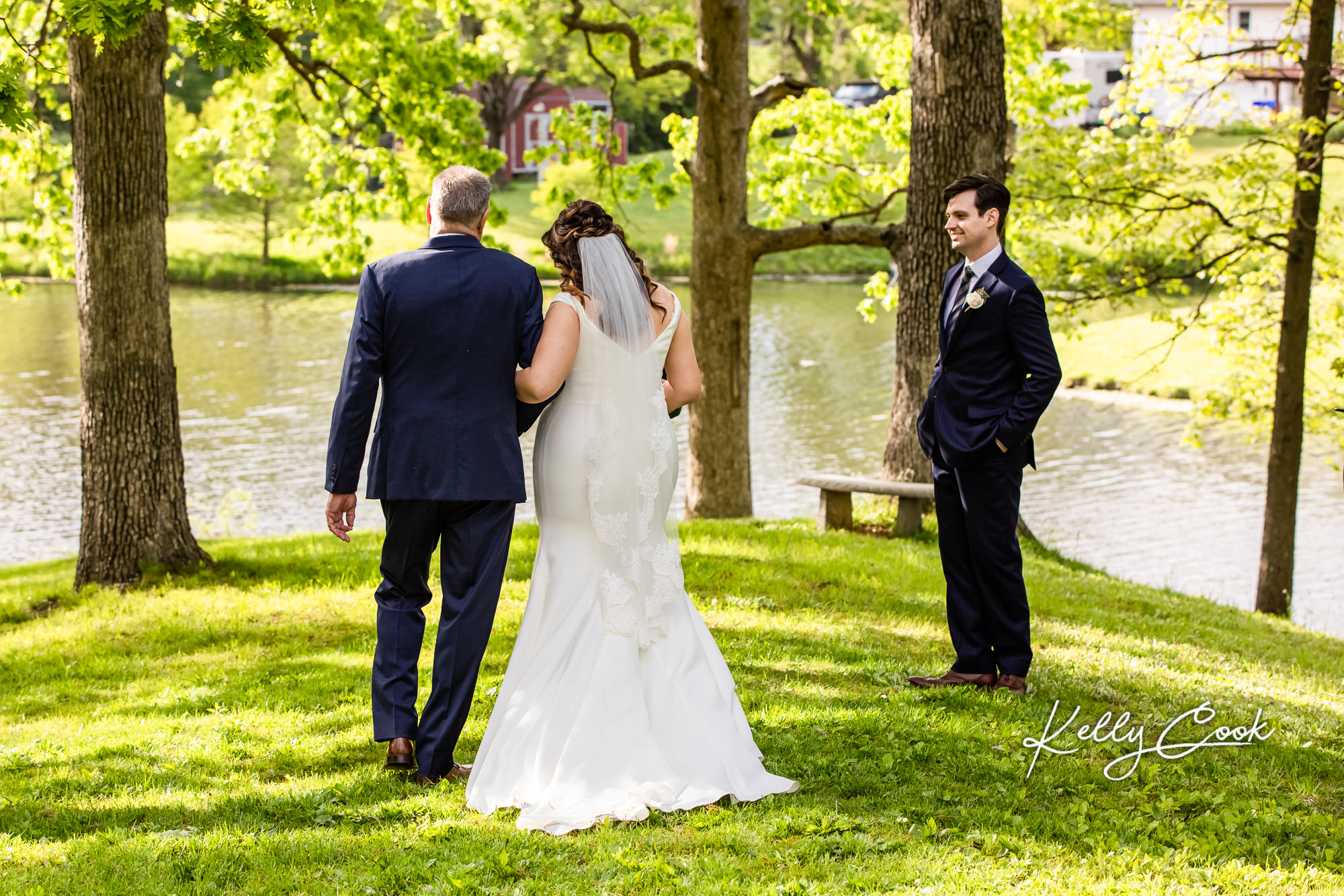 A bride and her father walking down the aisle for a backyard micro wedding