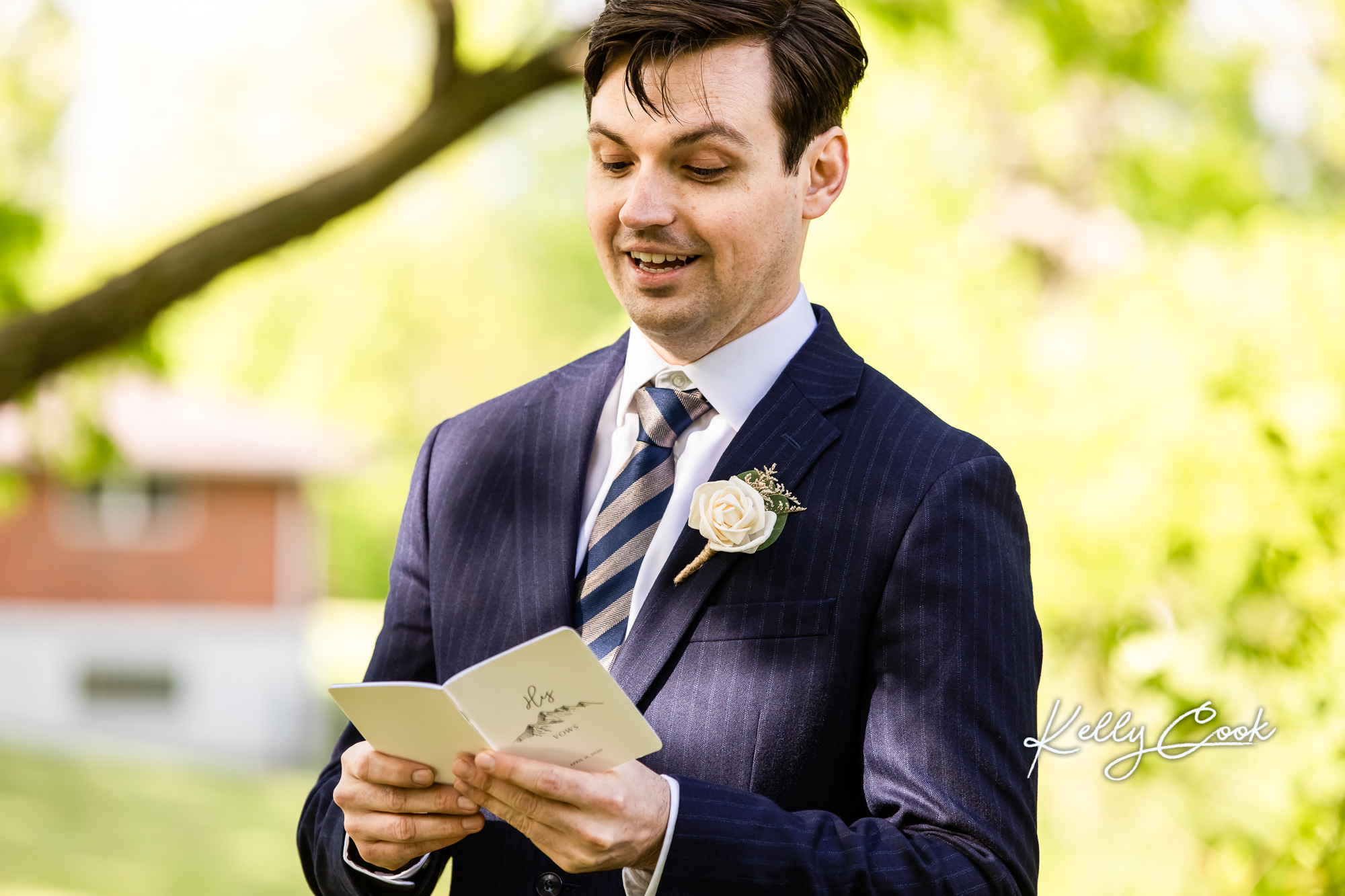 A groom reading his vows at his backyard micro wedding in St. Louis