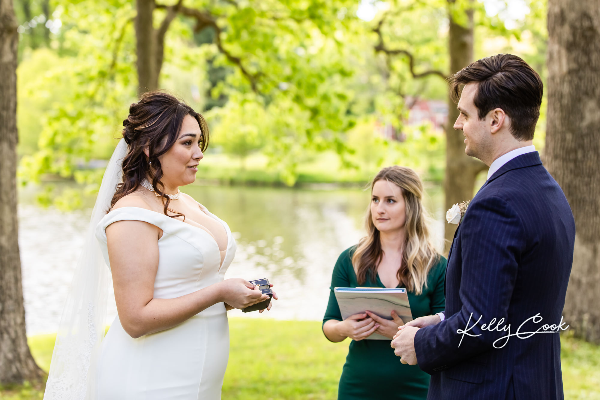 A couple exchanging rings at their backyard micro wedding in St. Louis