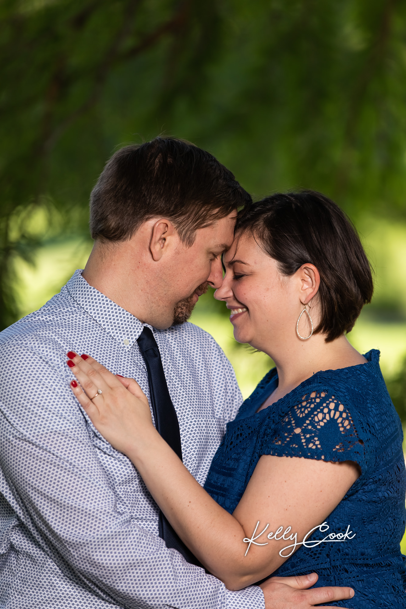 Romantic engaged couple in candid St. Louis engagement photos in Francis Park
