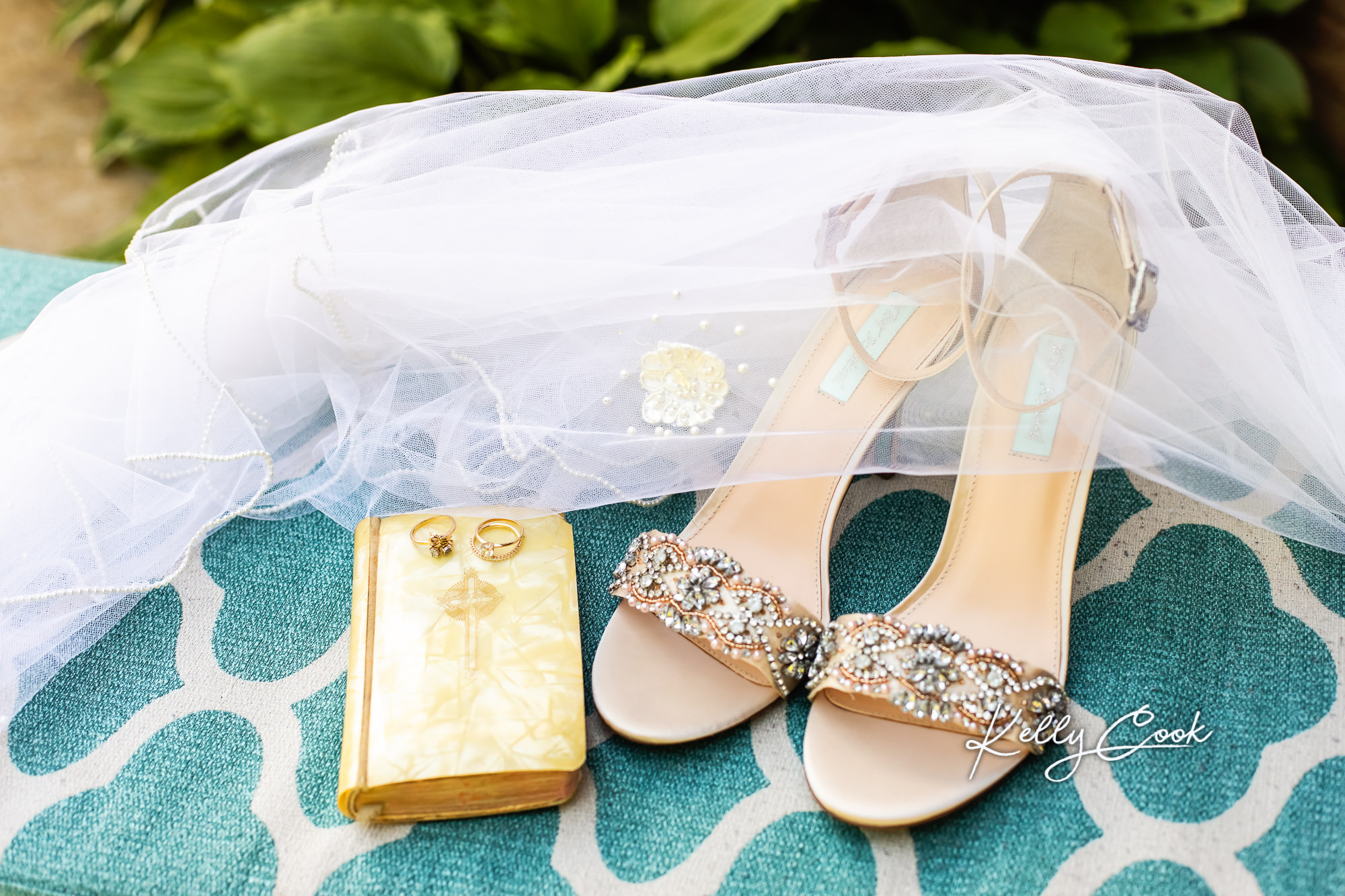 Wedding detail photo of the bride's shoes, jewelry, and veil