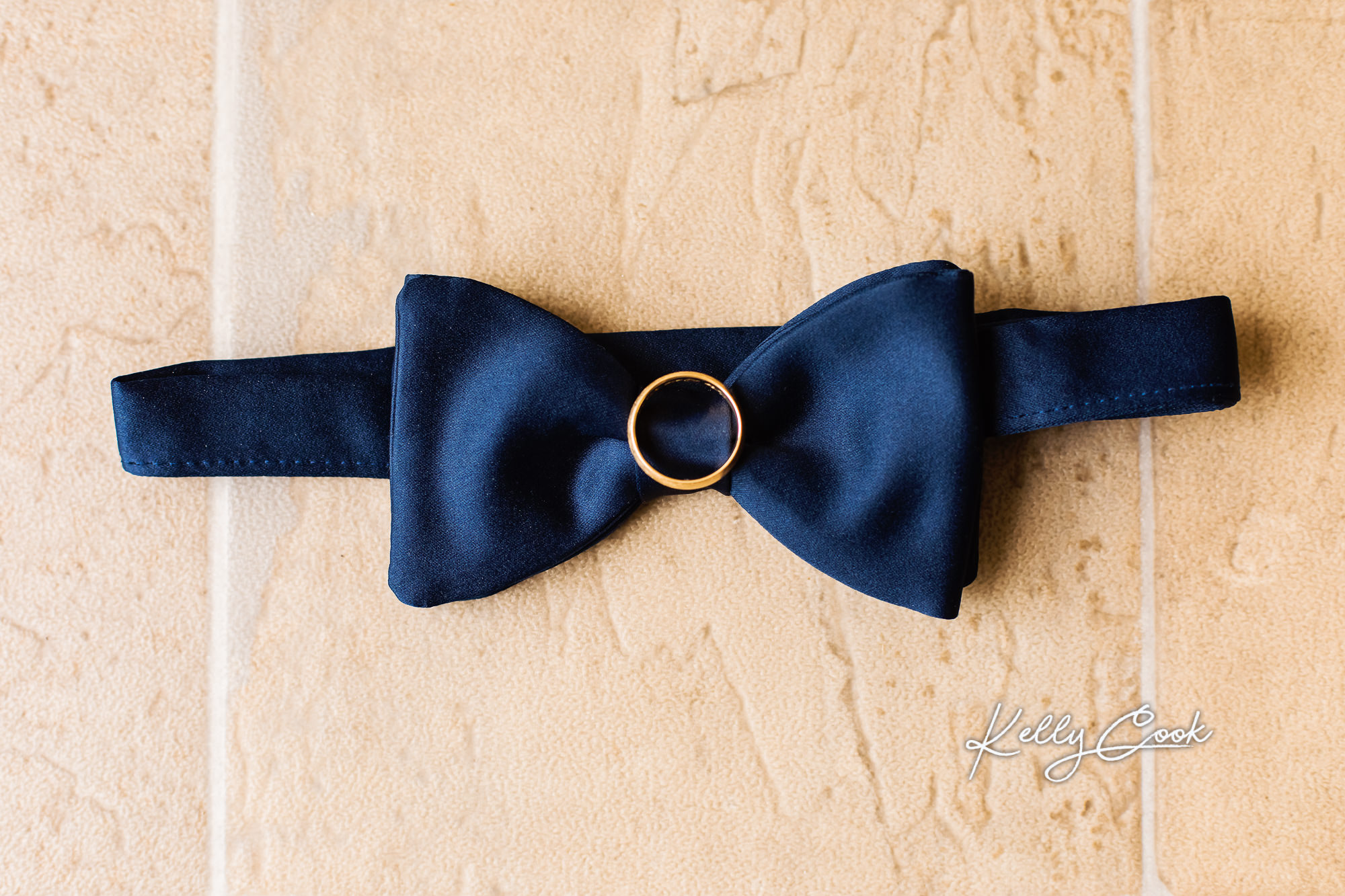 Wedding detail photo of the groom's tie and ring