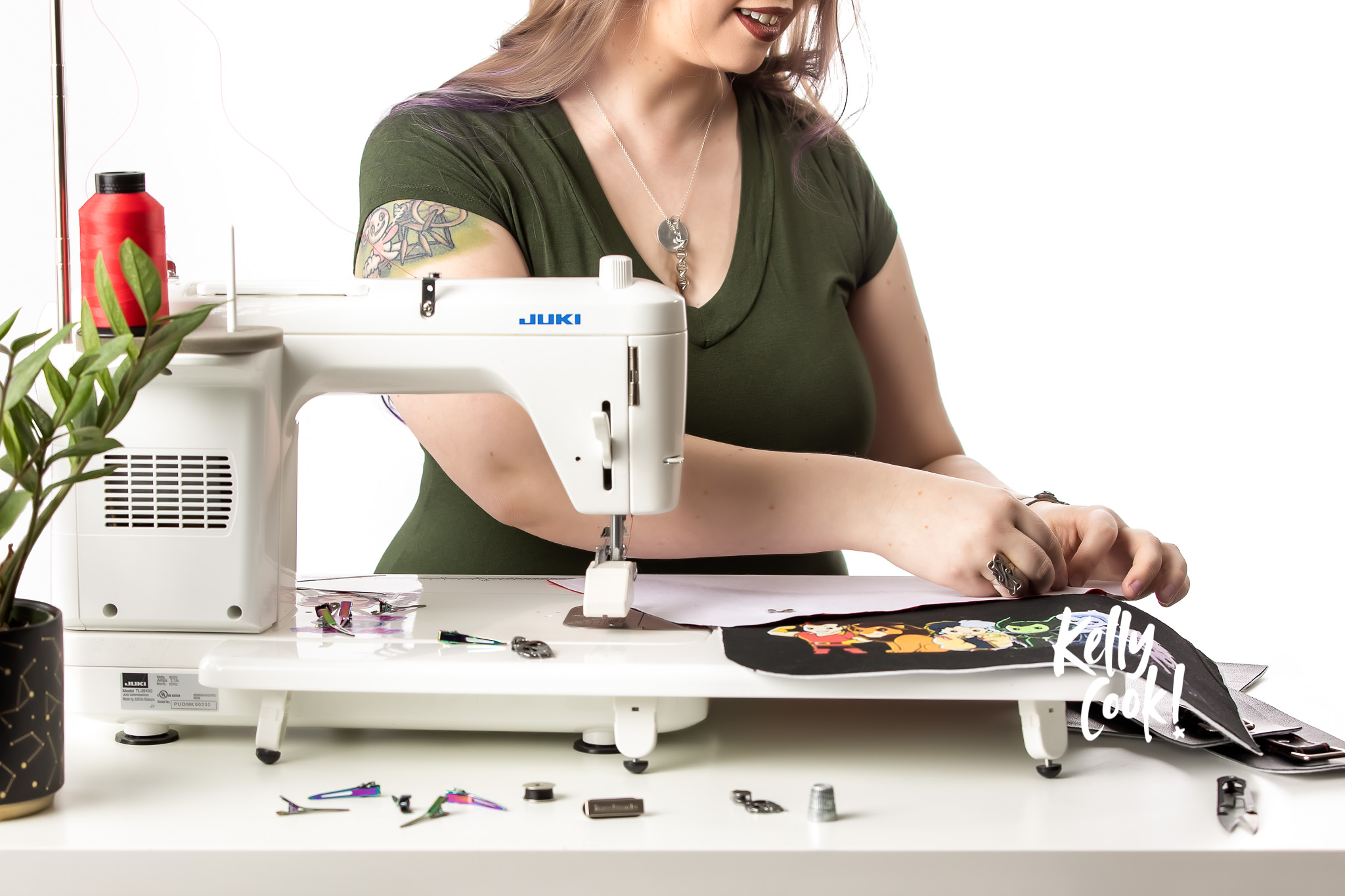 Woman sitting at a sewing machine working on a bag