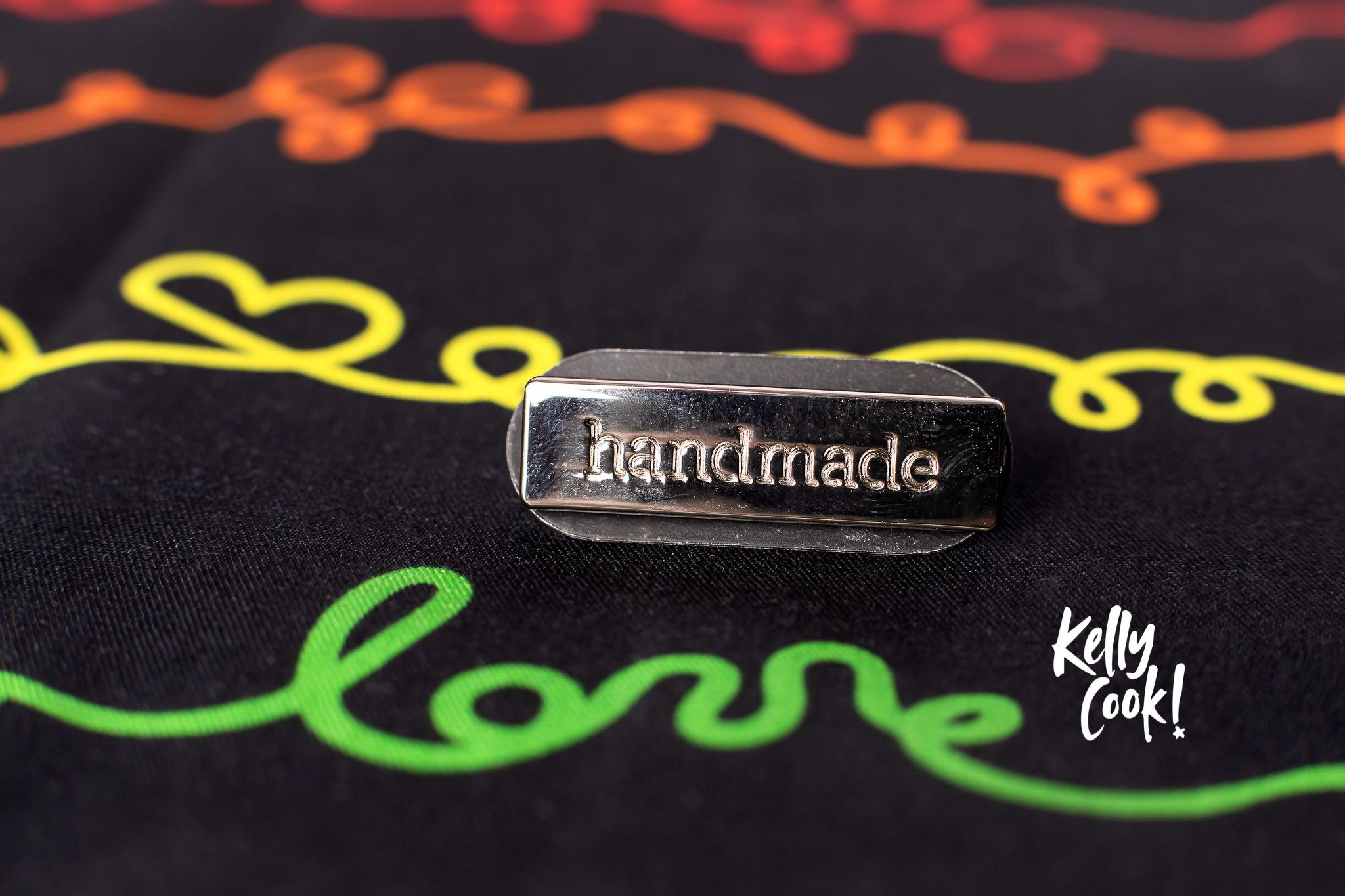 """Handmade"" pin on fabric"
