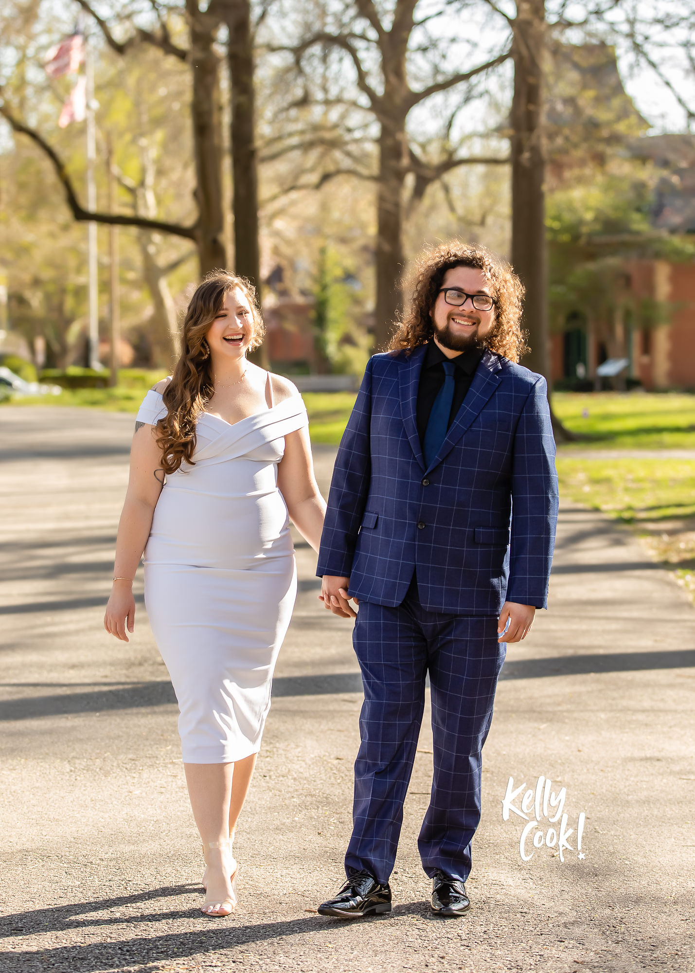 Engaged couple walking together in Lafayette Park in St. Louis