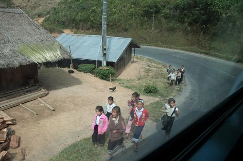 school children on road to Luang Prabang
