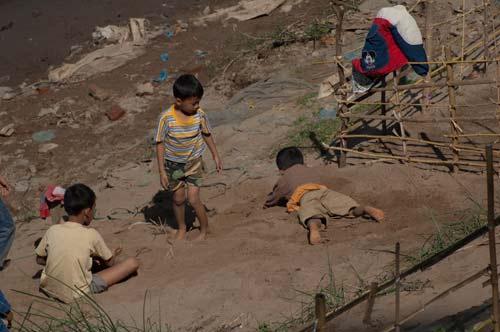 children playing on the edge of the Mekong River, Luang Prabang, Laos