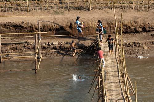 children diving in Nam Khan River, Luang Prabang, Laos