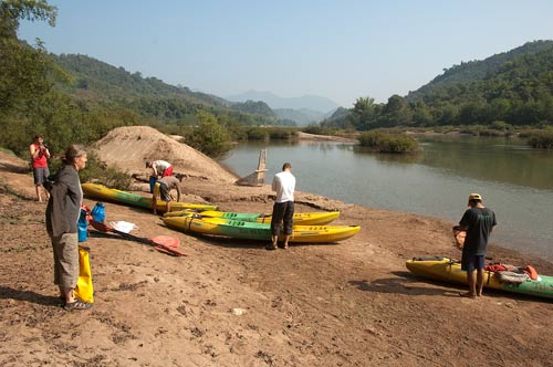 gearing up for kayak trip on the Nam Pa river, Laos