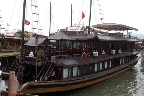 junk Imperial at tourist wharf, Ha Long, Vietnam