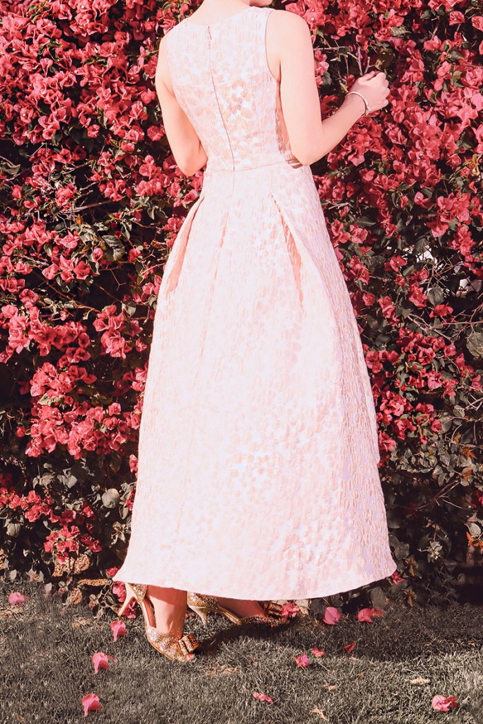 Kelly Golightly recreates photo of Audrey Hepburn and bougainvillea, Italy, 1955 by Norman Parkinson.