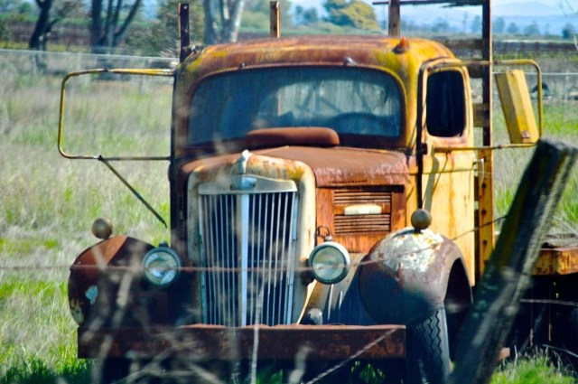 old truck in farm pasture