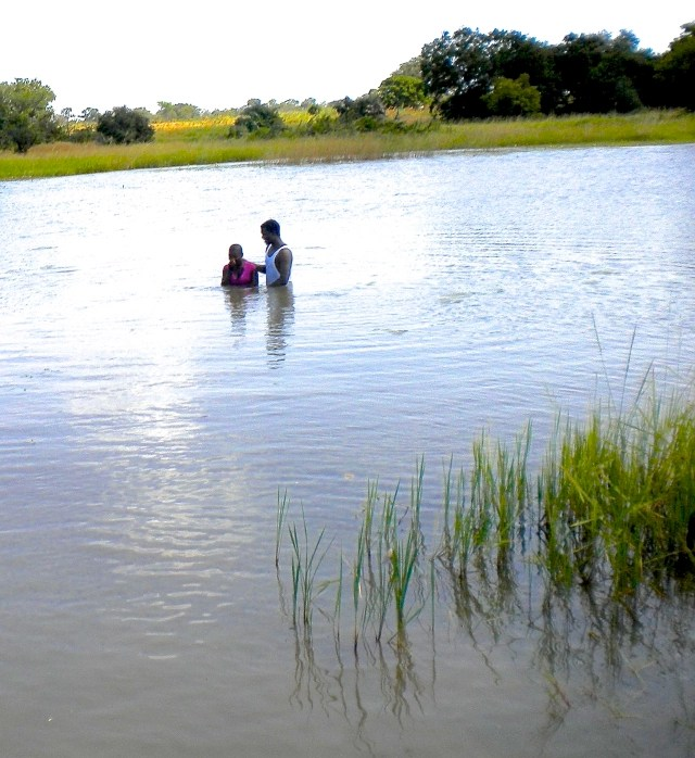 girl and pastor in water for a baptism