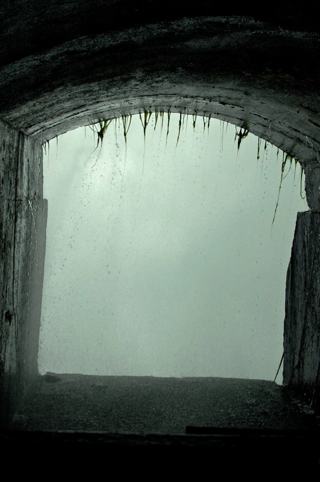 spooky tunnel opening into waterfalls