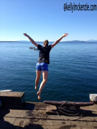 Girl leaping off dock into ocean. http://kellylmckenzie.com/