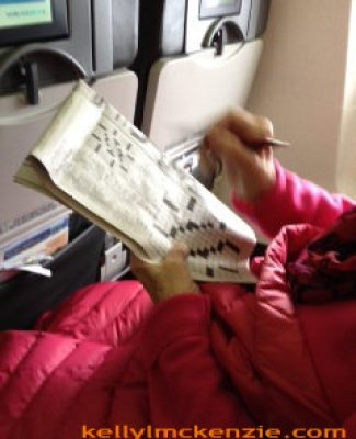 Mom with crossword on plane. http://kellylmckenzie.com/living-life-to-the-fullest-at-91/