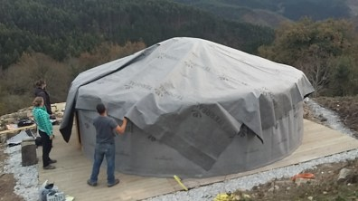 Assembling yurt layers plastic water proofing sheet