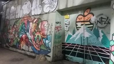 Under bridge colourful line work graffiti