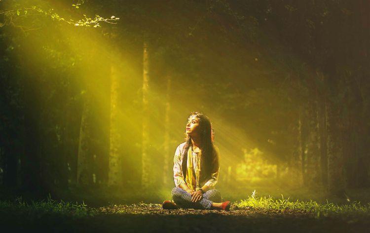 woman embracing light