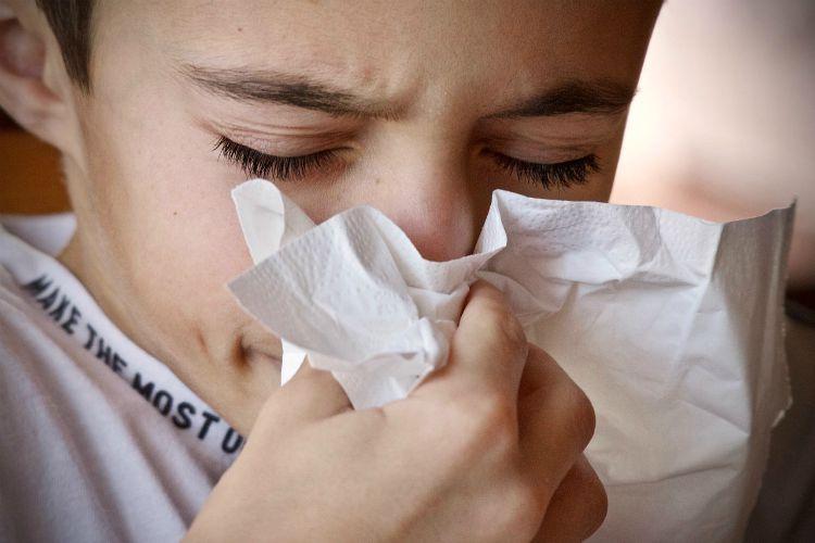 boy sneezing sinuses