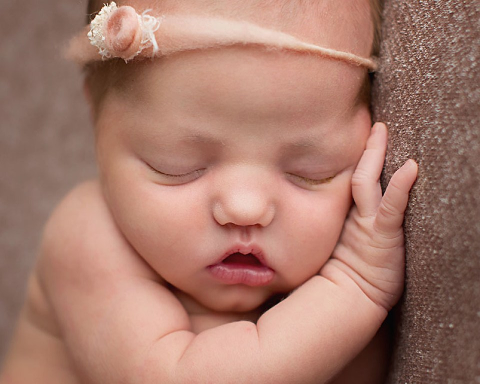 Close up of sleepy baby face