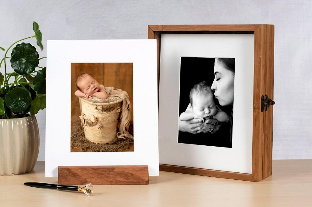 Printed newborn photographs in box