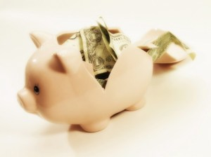 Broken piggy bank --- Image by © Royalty-Free/Corbis
