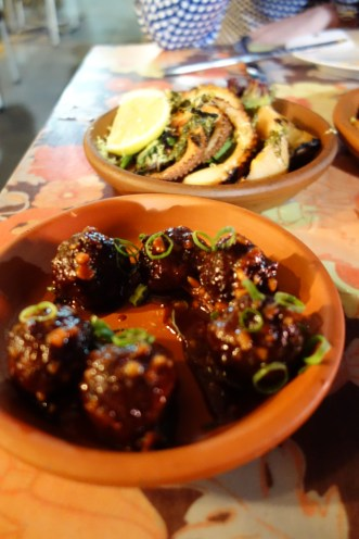 Meatballs w chorizo in romesco sauce & chargrilled octopus