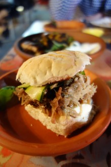 Montadito - smoked pork shoulder slow cooked in beer w aioli + pickled zucchini on a bun