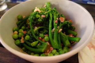 Sautéed peas and brussel sprout salad w broccolini, bacon chips and pine nuts