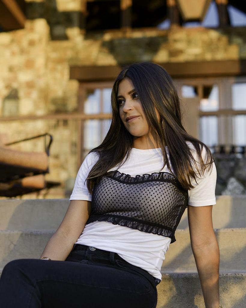 Lifestyle blogger Kelsey Kaplan of Kelsey Kaplan Fashion wearing mesh over-lay t-shirt