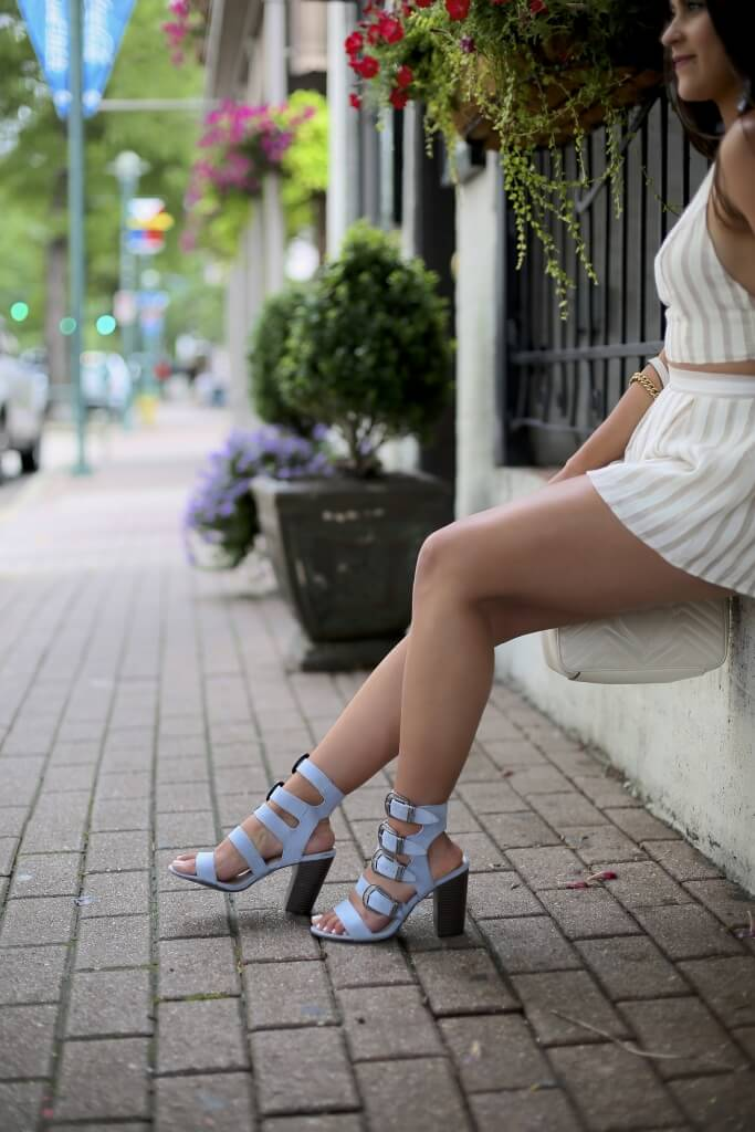 Lifestyle blogger Kelsey Kaplan of Kelsey Kaplan Fashion wearing two-piece set and buckle sandals