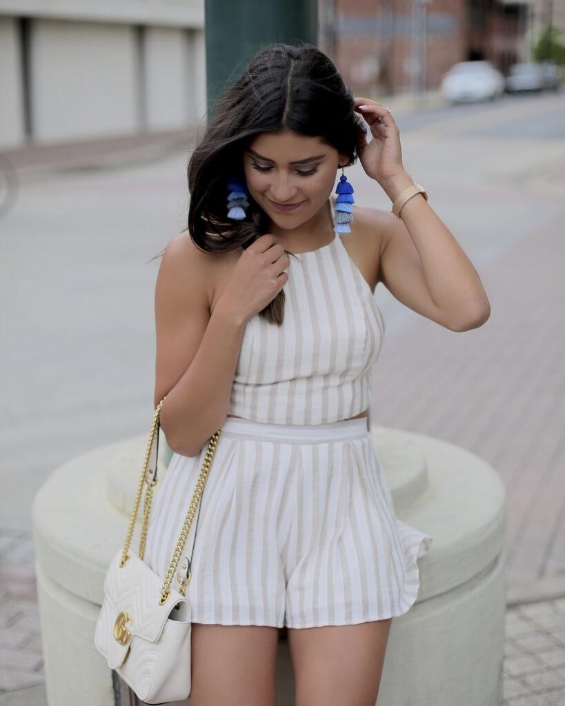 Lifestyle blogger Kelsey Kaplan of Kelsey Kaplan Fashion wearing two-piece set and blue tassel earrings