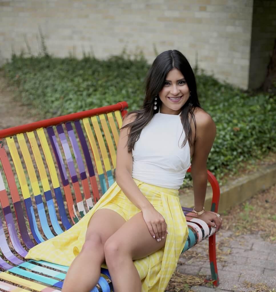 Lifestyle blogger Kelsey Kaplan of Kelsey Kaplan Fashion wearing  yellow plaid skort and pearl earrings