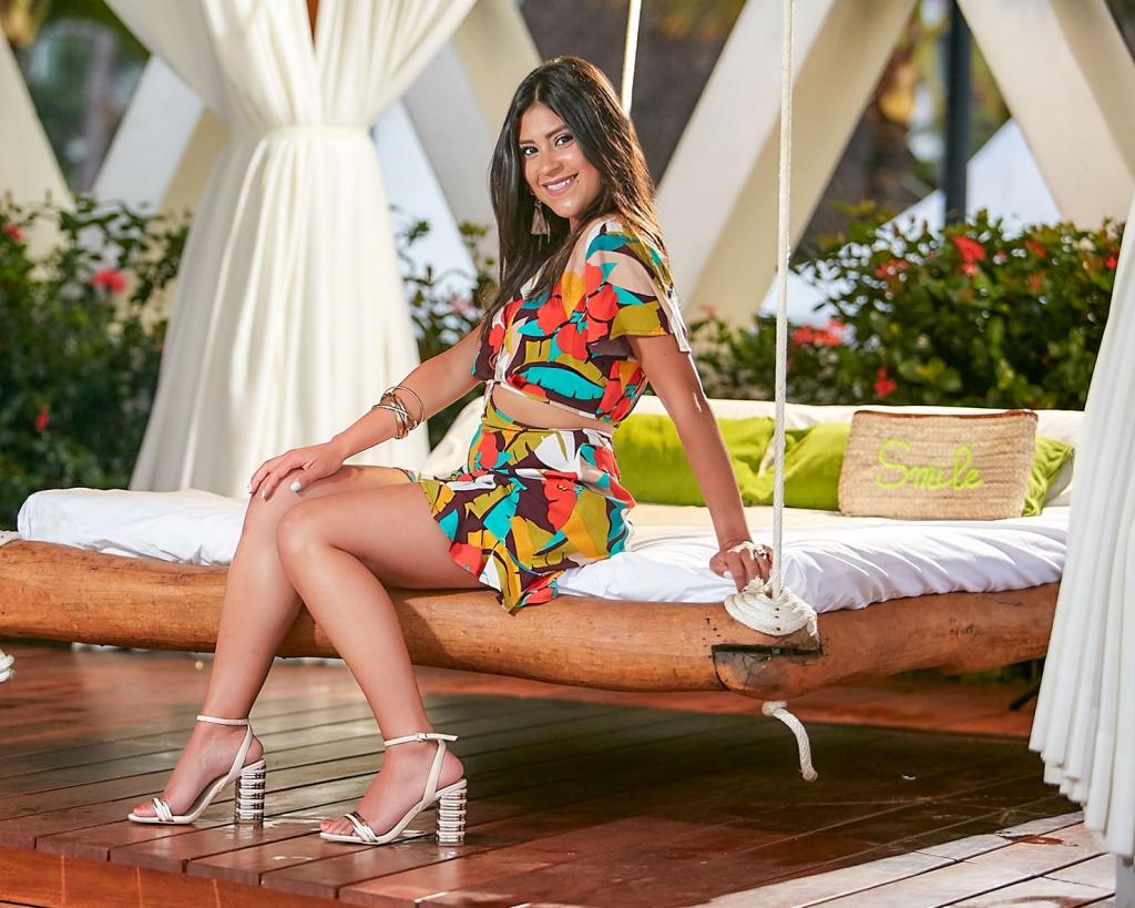 Lifestyle blogger Kelsey Kaplan of Kelsey Kaplan Fashion wearing tropical print romper and rose gold sandals