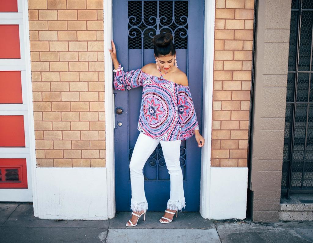 Kelsey Kaplan of Kelsey Kaplan Fashion in white fringe hem jeans