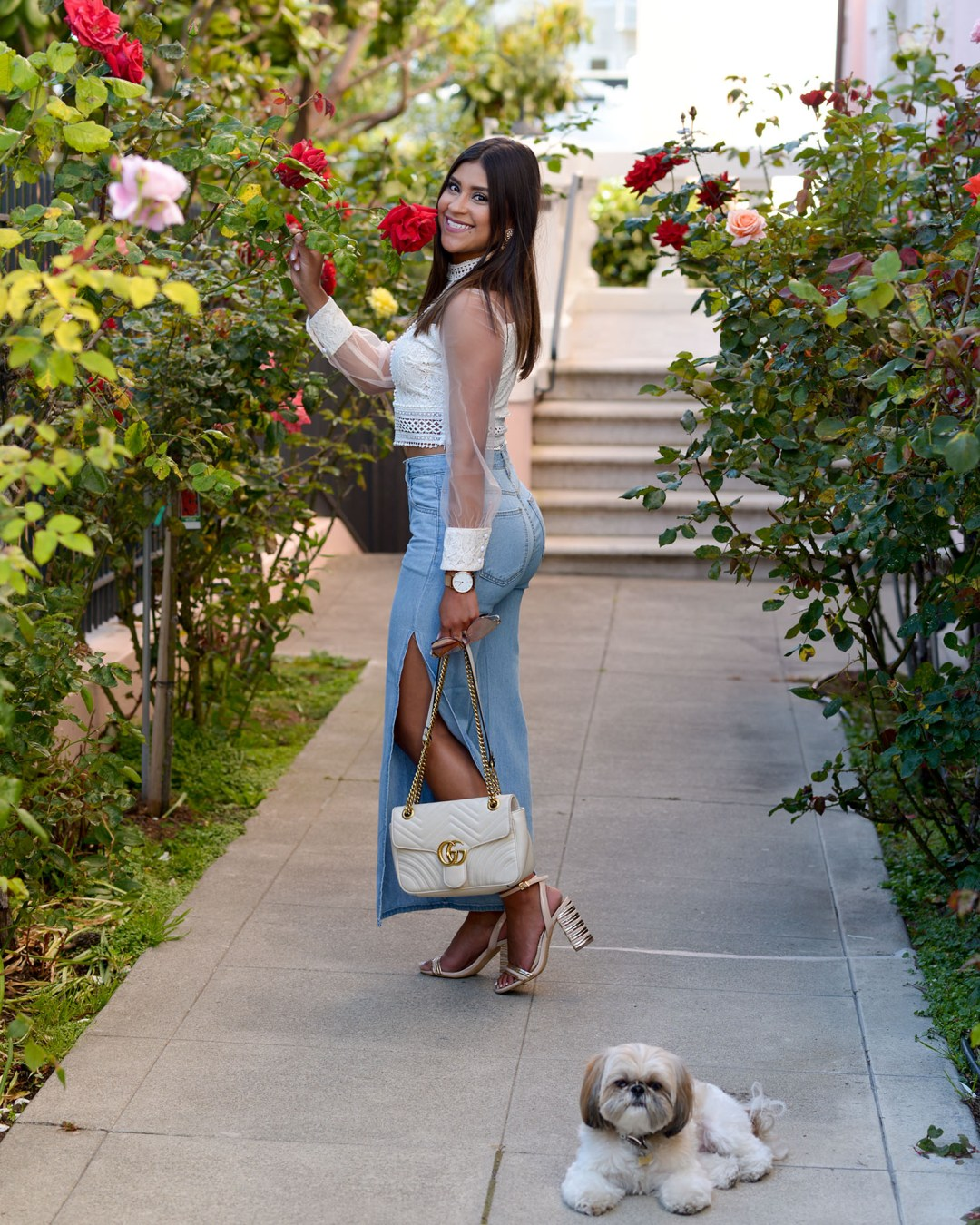 Life style blogger Kelsey Kaplan of Kelsey Kaplan Fashion wearing white gucci purse and side slit jeans