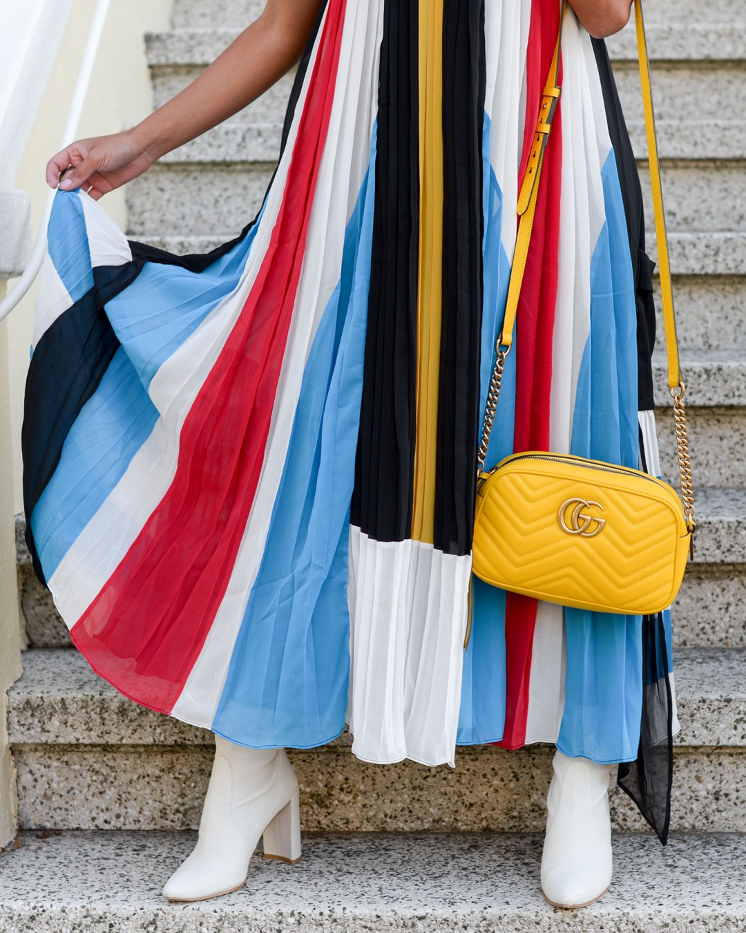 Life style blogger Kelsey Kaplan of Kelsey Kaplan Fashion wearing pleated maxi dress and yellow gucci purse