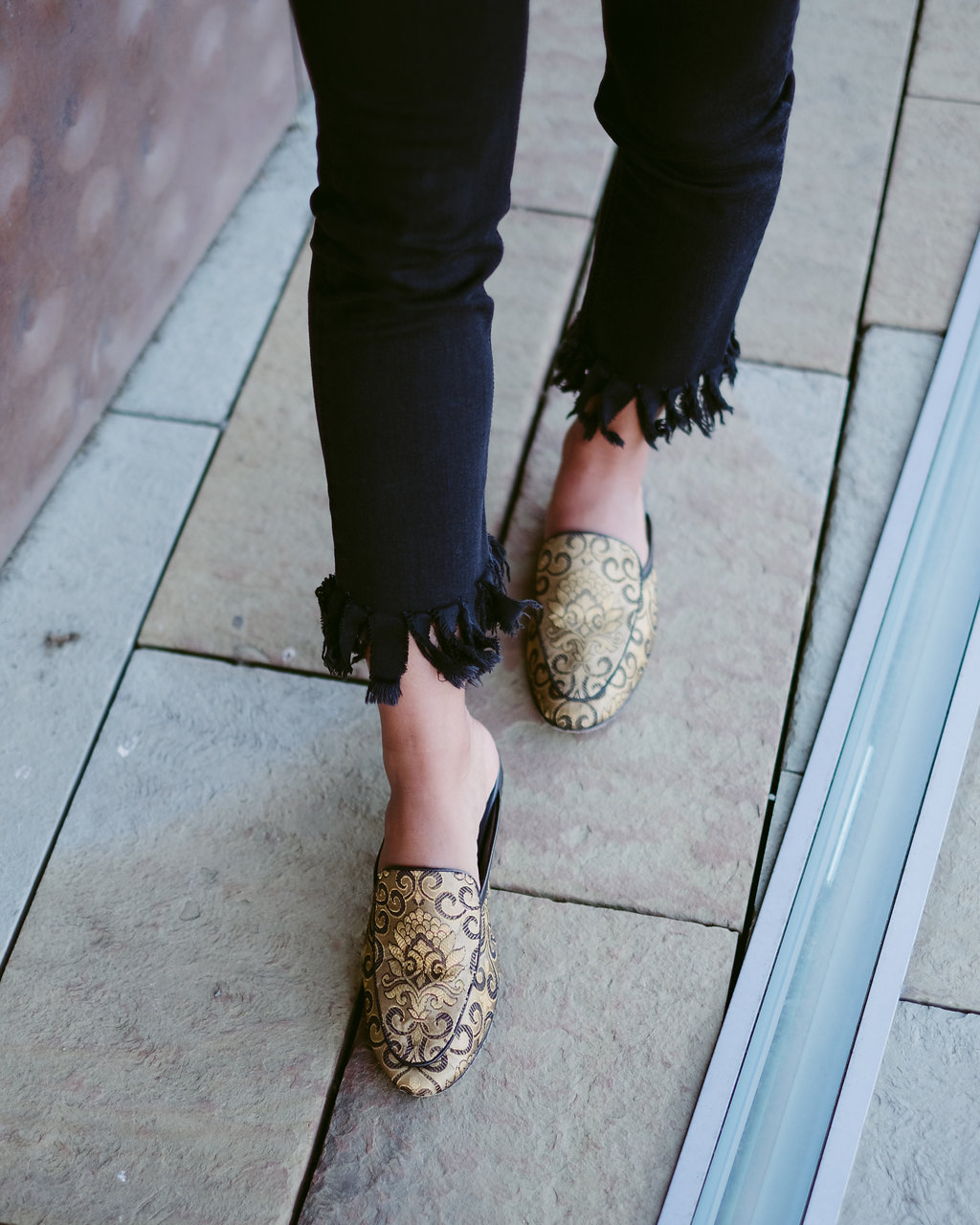 Life style blogger Kelsey Kaplan off Kelsey Kaplan Fashion wearing black and gold seychelles loafers
