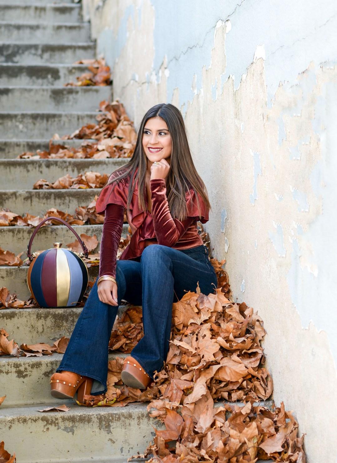 Lifestyle blogger Kelsey Kaplan of Kelsey Kaplan Fashion wearing velvet bodysuit and bowling ball bag