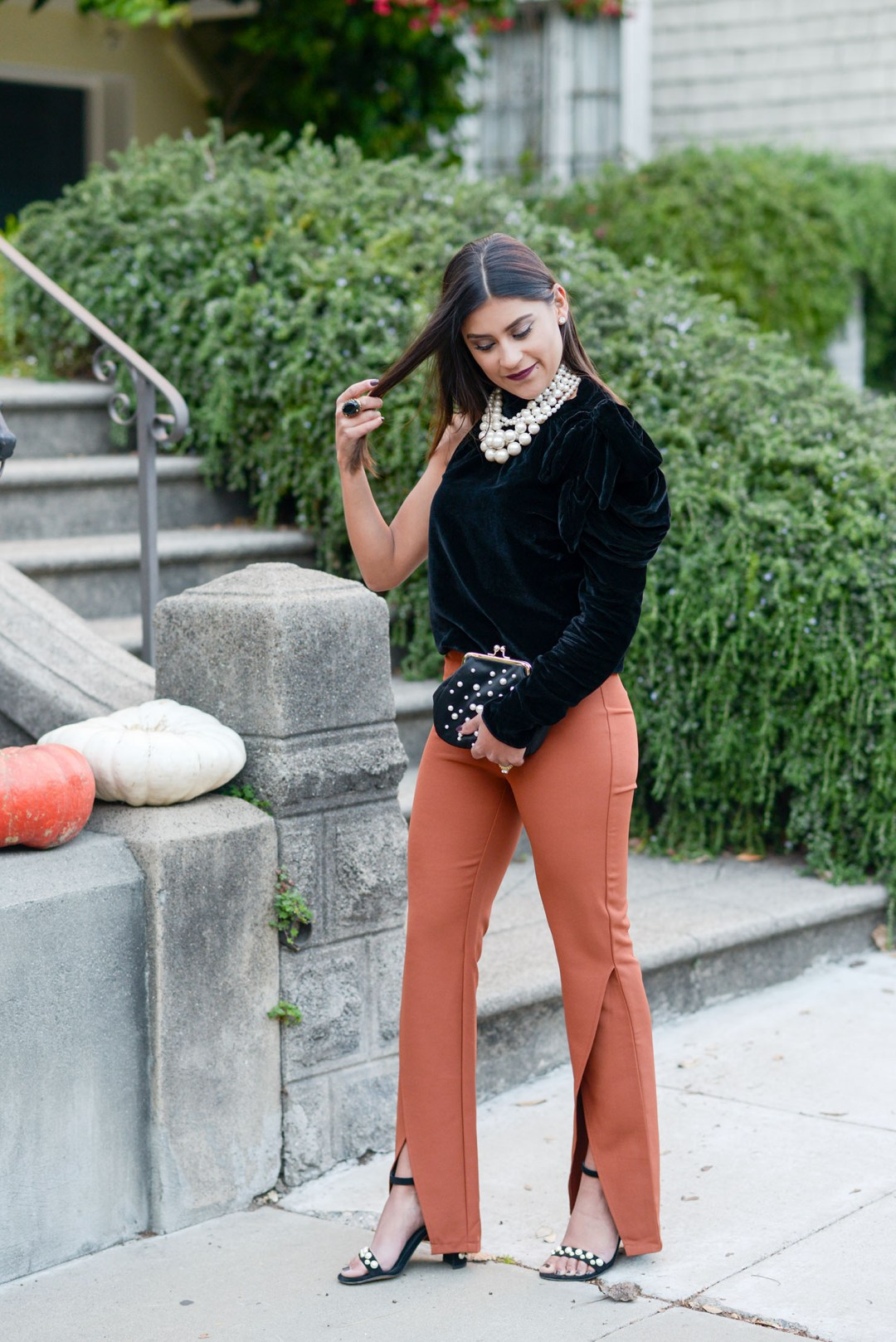 Lifestyle blogger Kelsey Kaplan of Kelsey Kaplan Fashion wearing orange trousers and pearl Stuart Weitzman sandals