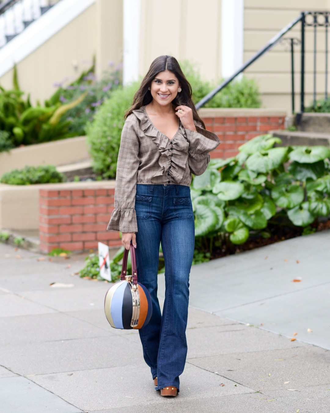 Lifestyle blogger Kelsey Kaplan of Kelsey Kaplan Fashion wearing plaid crop top and bell bottom jeans