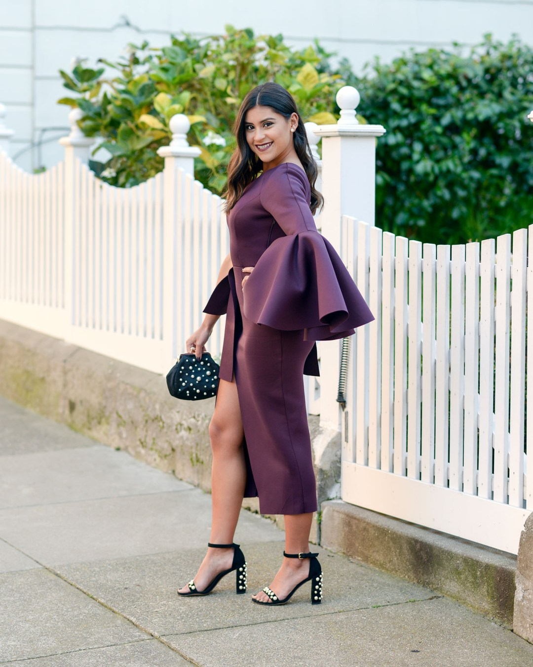 Lifestyle blogger Kelsey Kaplan of Kelsey Kaplan Fashion wearing scuba knit midi dress and Stuart Weitzman pearl sandals