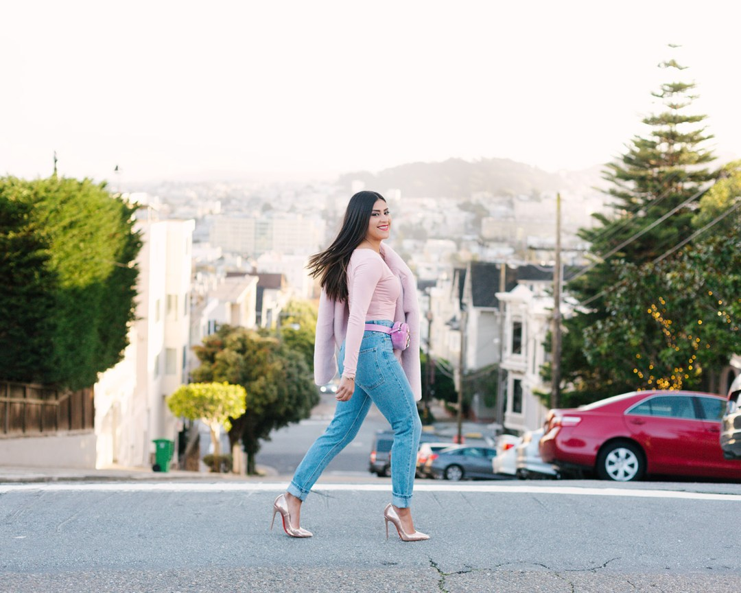 Lifestyle blogger Kelsey Kaplan of Kelsey Kaplan Fashion wearing mom jeans and Christian Louboutin sequin pumps