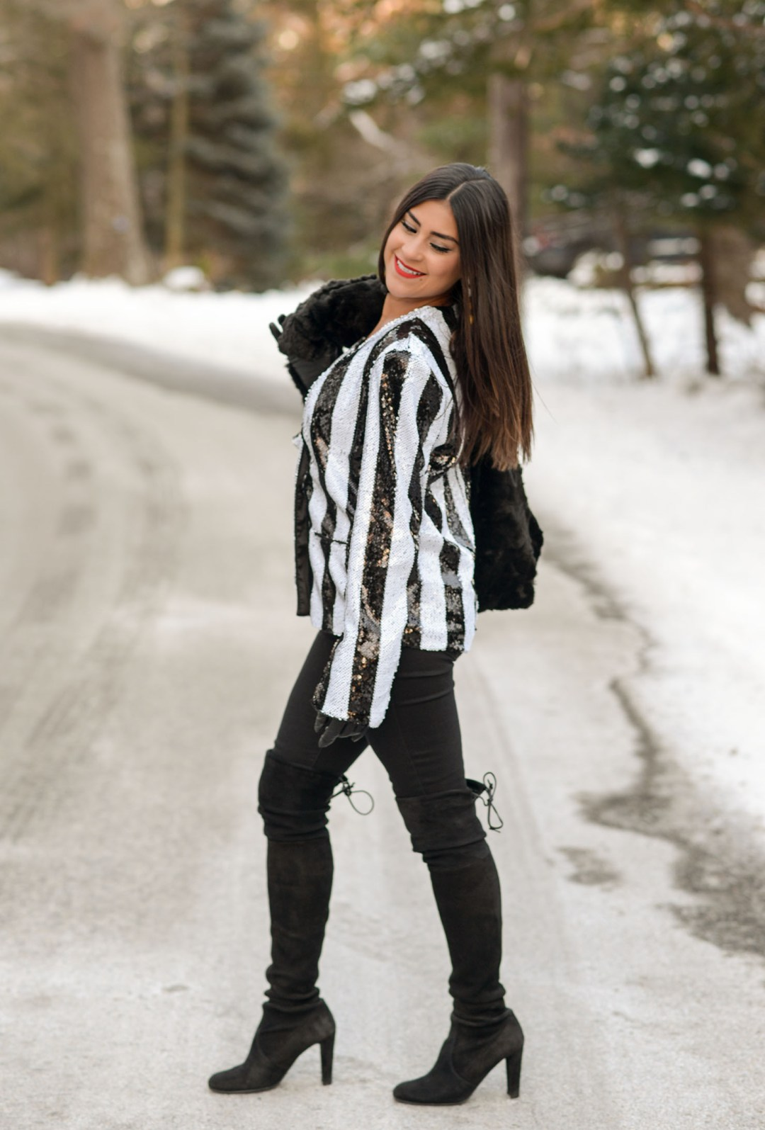 Lifestyle blogger Kelsey Kaplan of Kelsey Kaplan Fashion wearing sequin blazer and Stuart Weitzman OTK boots
