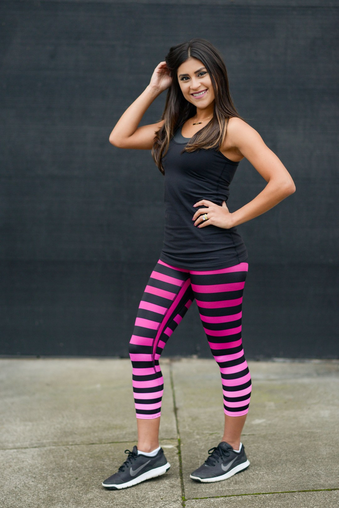 Lifestyle blogger Kelsey Kaplan of Kelsey Kaplan Fashion wearing k-deer stripe pants to The Bar Method