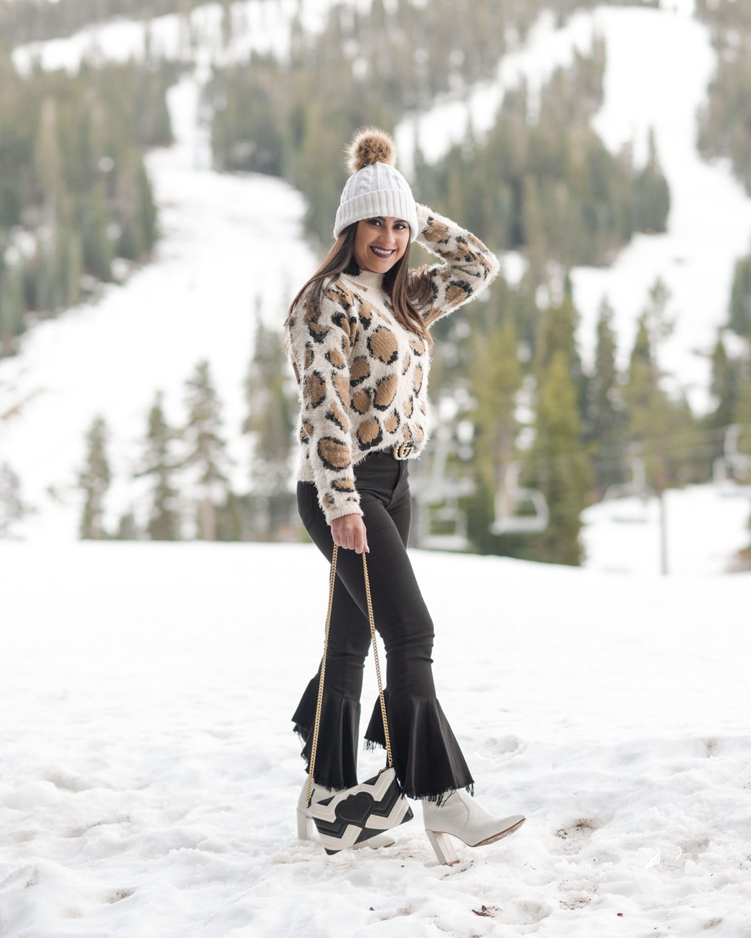 Lifestyle blogger Kelsey Kaplan of Kelsey Kaplan Fashion wearing leopard sweater at Ritz Carlton Lake Tahoe
